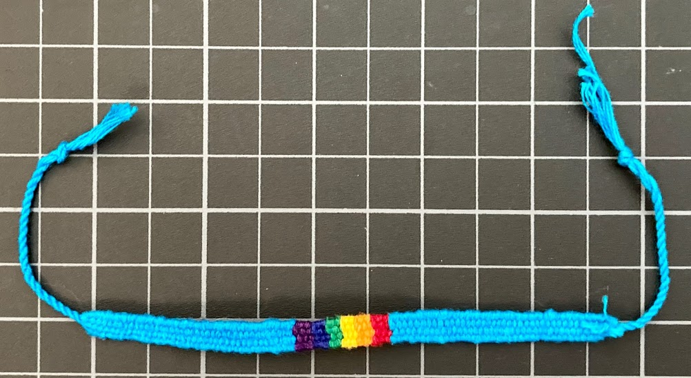 Rainbow Cotton Block Friendship Bracelet 1/4 Inch Light Blue Background rainbow