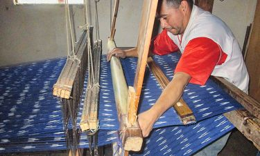 Men Using Large Loom